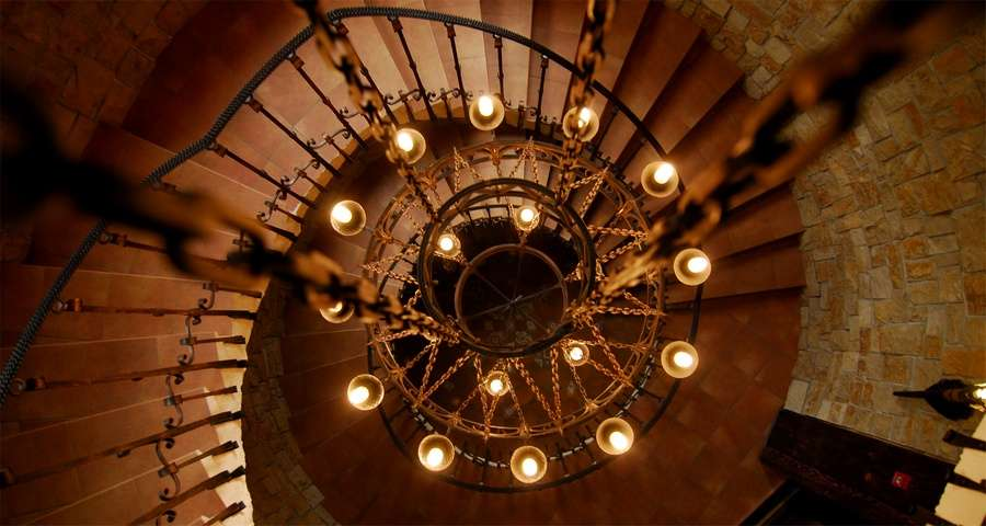 Chandelier above the spiral staircase of Vezha Vedmezha