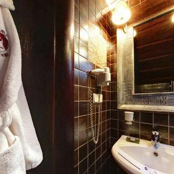 Ванна кімната у апартаментах Вежа