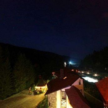 Night view of the pool and the nature of the Carpathians from the balcony of of apartments Vezha