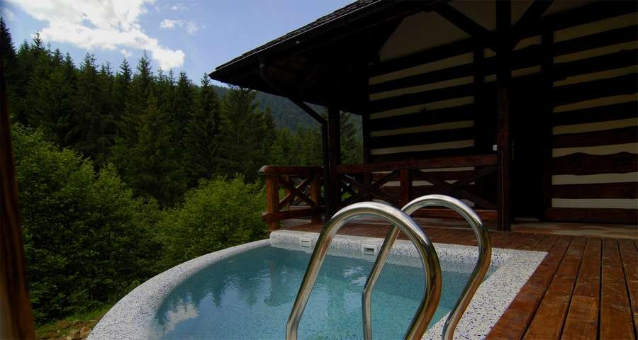 Outdoor pool of the Russian bathhouse in the Carpathians, summer, Vezha Vedmezha