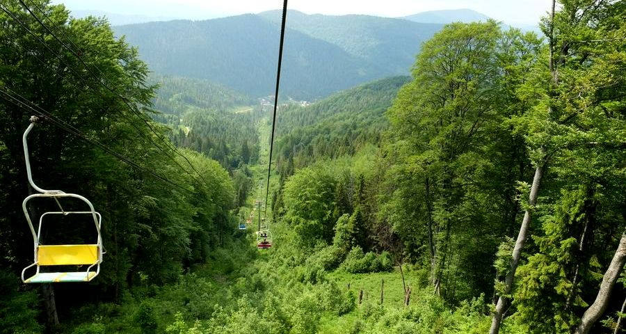 In ski lift over the Carpathian Mountains in summer