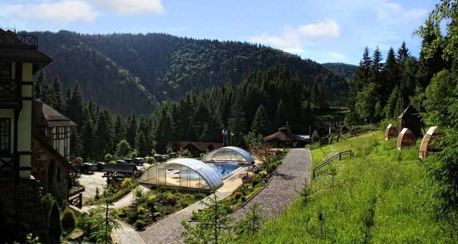 Recreation in the hotel with an outdoor pool in the Carpathians, summer