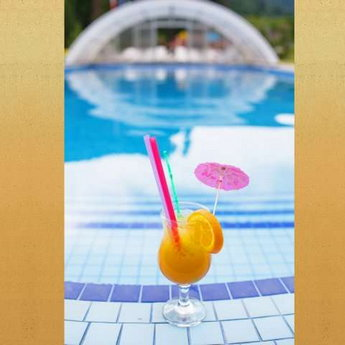 Summer cocktail by the pool at a hotel in the Carpathians, 2018